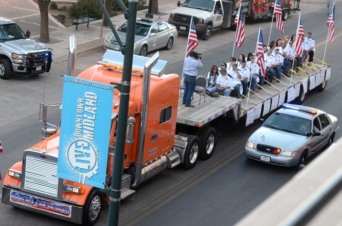 **FILE** A flatbed truck carries wounded veterans and their families during a parade on Nov. 15, 2012, in Midland, Texas, before it was struck by a train. Four veterans were killed