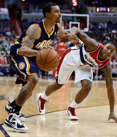 Indiana Pacers guard George Hill tries to get past Washington Wizards guard Bradley Beal during the second half of the Pacers' 96-89 road win on Nov. 19, 2012. (Associated Press)