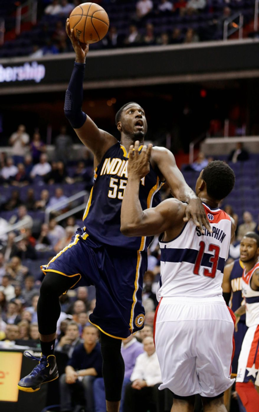 Indiana Pacers center Roy Hibbert shoots over Washington Wizards forward Kevin Seraphin during the second half of the Pacers' 96-89 road win on Nov. 19, 2012. (Associated Press)