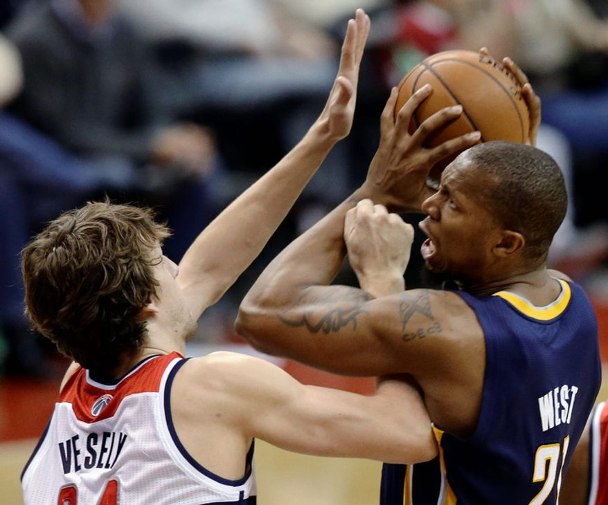 Indiana Pacers forward David West gets tangled up with Washington Wizards forward Jan Vesely during the second half of the Pacers' 96-89 road win on Nov. 19, 2012. (Associated Press)