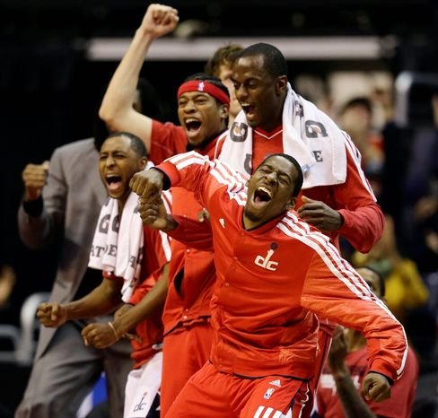 Washington Wizards' A.J. Price (left), Cartier Martin, Earl Barron, and Jordan Crawford (front right) cheer as their team pulls within one point during the second half of the Pacers' 96-89 road win on Nov. 19, 2012. (Associated Press)