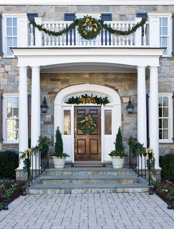 Photograph provided by Angie Seckinger  Interior designer Shanon Munn suggests pulling your holiday decorations together by using one fabric in multiple places, starting with the bow on your front-door wreath.
