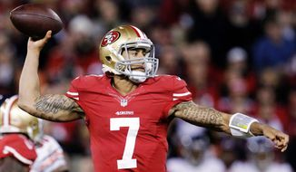 San Francisco quarterback Colin Kaepernick showed a cool demeanor and a hot hand against Chicago on Monday night. (Associated Press)