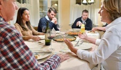 Anne Brennan (right) of Hingham, Mass., and (from left) brother-in-law Steve Marshall, of Hingham; niece Rebecca Malone and husband Brian Malone, of Duxbury, Mass.; and nephew Andrew Marshall, of Quincy, Mass., talk politics over dinner. (Associated Press)