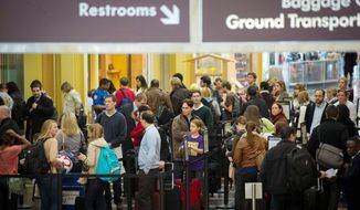 ** FILE ** Thanksgiving travelers line up at security at Ronald Reagan Washington National Airport in Arlington on Wednesday, Nov. 21, 2012. (Rod Lamkey Jr./The Washington Times)