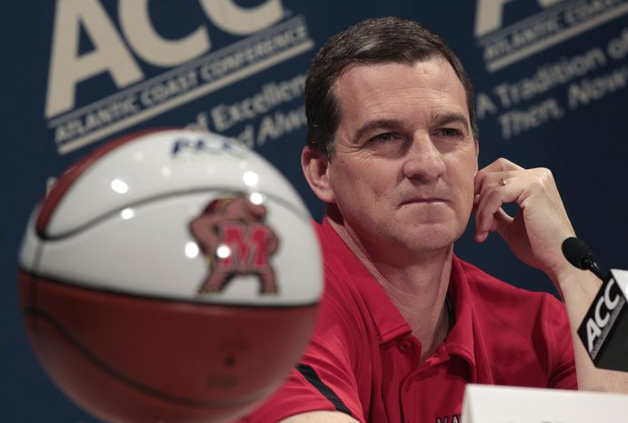 FILE - This Oct. 19, 2011 file photo shows Maryland coach Mark Turgeon listening to a question during the ACC Operation Basketball media day in Charlotte, N.C. Maryland is set to announce it is joining the Big Ten. The Big Ten Network tweeted that it will cover the school's news conference Monday afternoon, Nov. 19, 2012,  to announce Maryland's decision to leave the Atlantic Coast Conference.(AP Photo/Chuck Burton, File)
