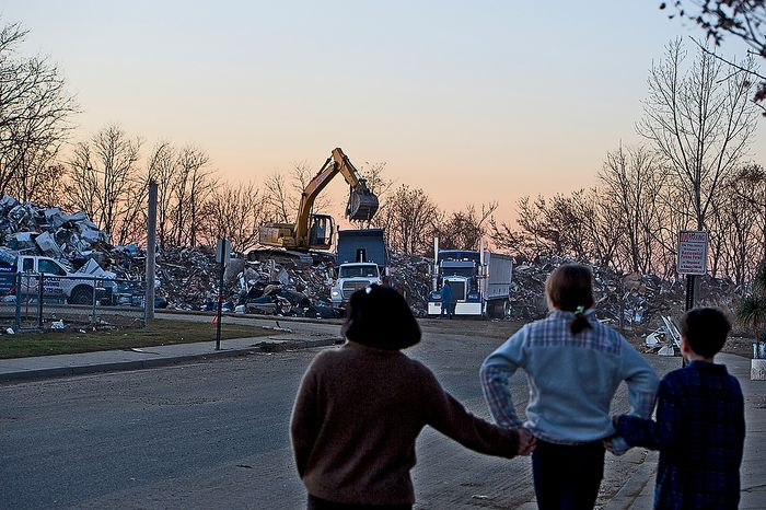 Tiffany, Abbi and Andrew hold hands while they look at a street where houses are being demolished in Union Beach, N.J. on Wednesday, Nov. 21, 2012. They have donated items here that they collected in Project Keep Them Cozy, which Abbi, 12, and Andrew, 9, spearheaded. The family is spending their Thanksgiving up here volunteering. (Barbara L. Salisbury/The Washington Times)