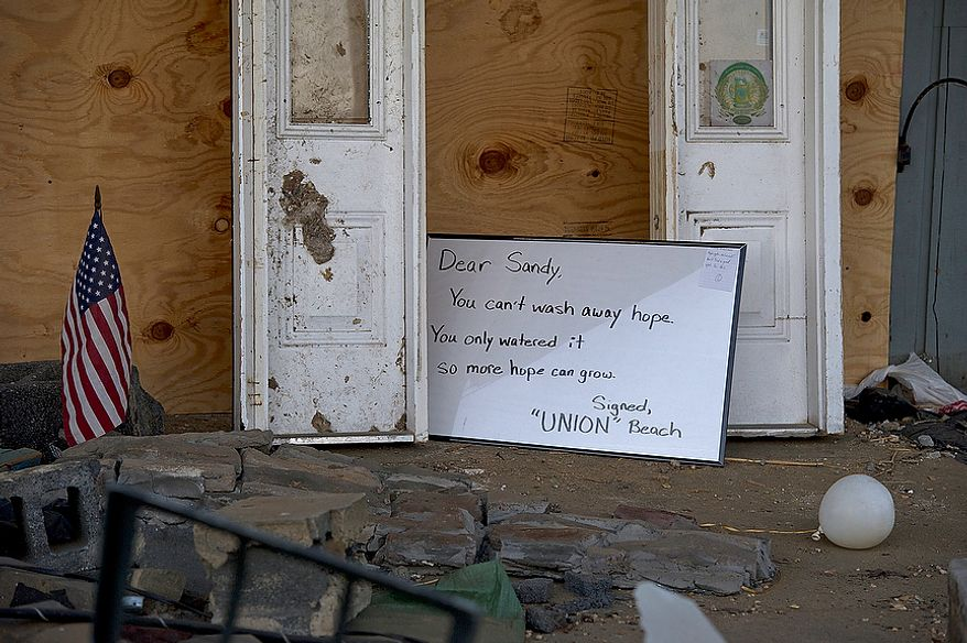 A sign sits outside a destroyed restaurant in Union Beach, N.J. on Wednesday, Nov. 21, 2012.  (Barbara L. Salisbury/The Washington Times)