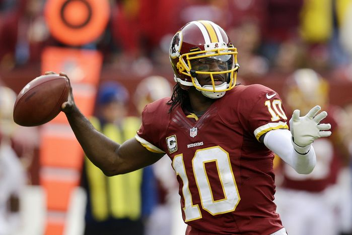 Washington Redskins quarterback Robert Griffin III passes the ball during the second half of an NFL football game against the Philadelphia Eagles in Landover, Md., Sunday, Nov. 18, 2012. The Washington Redskins defeated the Philadelphia Eagles 31-6. (AP Photo/Alex Brandon)