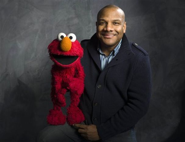 """** FILE ** In this Jan. 24, 2011, file photo, then-Elmo puppeteer Kevin Clash poses with the """"Sesame Street"""" muppet in the Fender Music Lodge during the 2011 Sundance Film Festival in Park City, Utah. (AP Photo/Victoria Will, File)"""