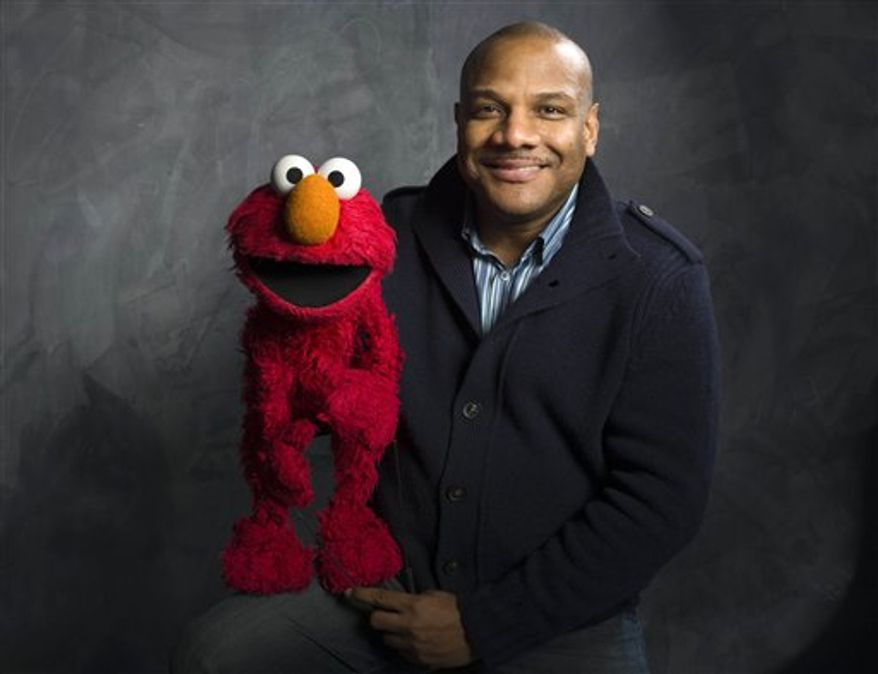"** FILE ** In this Jan. 24, 2011, file photo, then-Elmo puppeteer Kevin Clash poses with the ""Sesame Street"" muppet in the Fender Music Lodge during the 2011 Sundance Film Festival in Park City, Utah. (AP Photo/Victoria Will, File)"