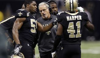 New Orleans Saints acting head coach Joe Vitt, center, talks with outside linebacker Jonathan Vilma (51) and strong safety Roman Harper (41) in the first half an NFL football game against the Atlanta Falcons at the Mercedes-Benz Superdome in New Orleans, Sunday, Nov. 11, 2012. (AP Photo/Bill Haber)