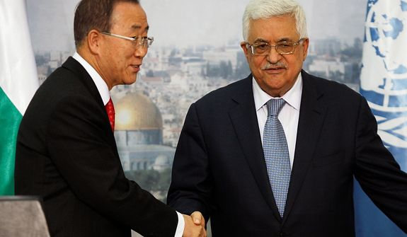 Palestinian President Mahmoud Abbas, right, and United Nations Secretary-General Ban Ki-moon, left, shake hands for photographers following a joint press conference in the West bank city of Ramallah, Wednesday, Nov. 21, 2012. World diplomats continued shuttling between Jerusalem, the West Bank and Cairo on Wednesday, trying to piece together a deal that would satisfy Israeli after a week of fighting and mounting casualties.(AP Photo/Majdi Mohammed)