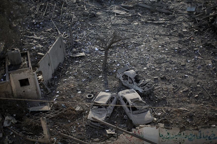 A general view of destroyed Hamas government complex known as Abu Khadra after an Israeli airstrike in Gaza City, Wednesday, Nov. 21, 2012. The Israeli military has been pounding Gaza with at least 30 strikes overnight, hitting government ministries, smuggling tunnels, a banker's empty villa and a Hamas-linked media office. Meanwhile, Secretary of State Hillary Rodham Clinton is in the West Bank, trying to help negotiate a truce between Israel and the militant Hamas, which controls the Gaza Strip.  (AP Photo/Bernat Armangue)