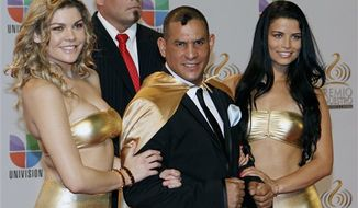 "**FILE** Former boxing champion Hector ""Macho"" Camacho (center) poses for photographers at his arrival to the Premio Lo Nuestro Music Awards in Miami on Feb. 16, 2012. (Associated Press)"