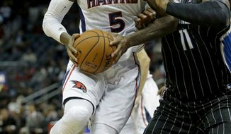Atlanta Hawks small forward Josh Smith (5) plays against Orlando Magic power forward Glen Davis (11) in an NBA basketball game Monday, Nov. 19, 2012, in Atlanta. (AP Photo/David Goldman)