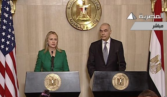 In this image made from Egyptian State Television, U.S. Secretary of State Hillary Rodham Clinton, left, and Egyptian Foreign Minister Mohammed Kamel Amr, right, give a joint news conference announcing a cease-fire between Israel and Hamas in Cairo, Egypt, Wednesday, Nov. 21, 2012. Egypt has announced a cease-fire agreement to end a week of fighting between Israel and Hamas militants in the Gaza Strip. Foreign Minister Mohammed Kamel Amr said the truce would take effect at 9 p.m. local time (2 p.m. EDT.) He made the announcement alongside visiting U.S. Secretary of State Hillary Rodham Clinton. (AP Photo/Egyptian State Television)
