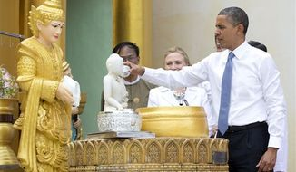 "** FILE ** In this Nov. 19, 2012, photo, President Barack Obama ""douses 11 flames"" as he tours the Shwedagon Pagoda with Secretary of State Hillary Rodham Clinton in Yangon, Myanmar. Little noticed during Obama's landmark visit to Myanmar was a significant concession that could shed light on whether that nation's powerful military pursued a clandestine nuclear weapons program, possibly with North Korea's help. (AP Photo/Carolyn Kaster)"