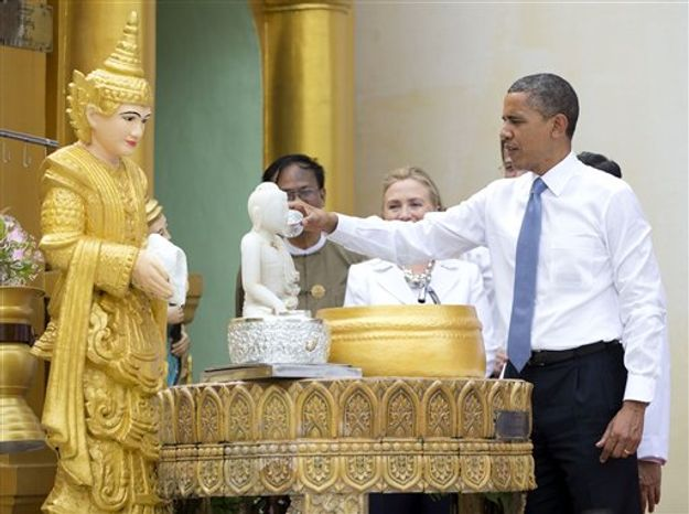"""** FILE ** In this Nov. 19, 2012, photo, President Barack Obama """"douses 11 flames"""" as he tours the Shwedagon Pagoda with Secretary of State Hillary Rodham Clinton in Yangon, Myanmar. Little noticed during Obama's landmark visit to Myanmar was a significant concession that could shed light on whether that nation's powerful military pursued a clandestine nuclear weapons program, possibly with North Korea's help. (AP Photo/Carolyn Kaster)"""