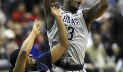 Georgetown forward Mikael Hopkins (3) grabs a rebound away from Duquesne guard Sean Johnson during their NCAA college basketball game, Sunday, Nov. 11, 2012, in Washington. Georgetown defeated Duquesne 61-55. (AP Photo/Richard Lipski)