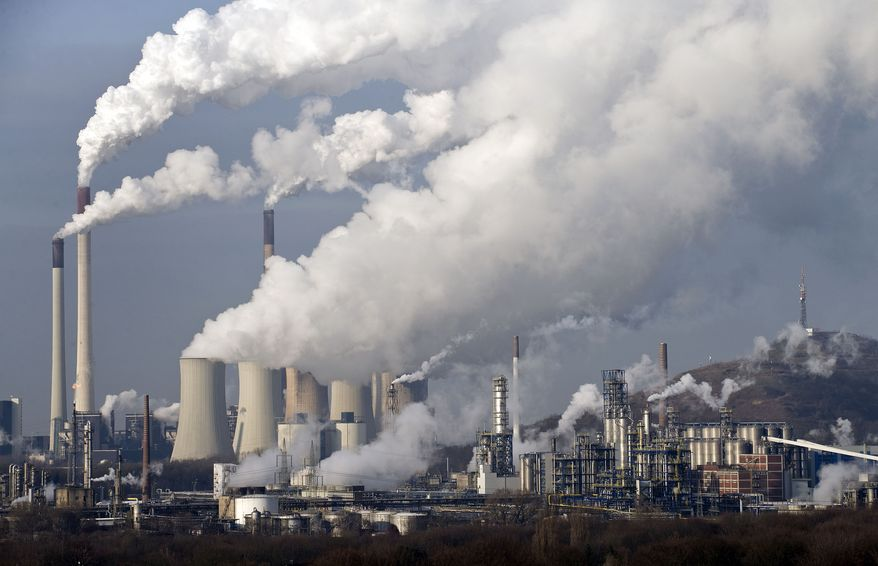 **FILE** Steam and smoke rise from a coal burning power plant in Gelsenkirchen, Germany, on Dec. 16, 2009. (Associated Press)