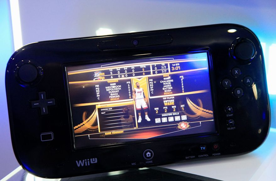 """Nintendo says its new Wii U, starting at $300, is its """"first new home video-game system in six years."""" The deluxe set is said to be worth the extra $50. (Associated Press)"""