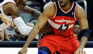 Nene came off the bench to score 12 points in 19:43 during the Wizards' 101-100 overtime loss in Atlanta on Wednesday night. (Associated Press)