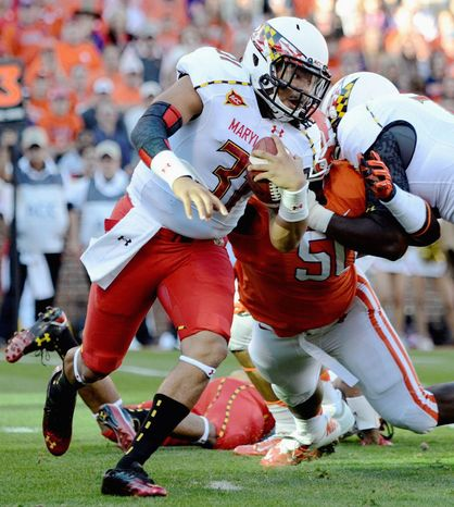 Linebacker Shawn Petty got his chance under center after quarterbacks C.J. Brown, Perry Hills, Devin Burns and Caleb Rowe were sidelined by injuries. Maryland enters its season finale at North Carolina on Saturday having lost five straight. (Associated Press)