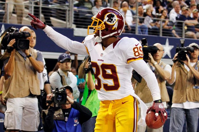Washington Redskins wide receiver Santana Moss (89) celebrates a touchdown catch against the Dallas Cowboys in the first half of an NFL football game, Thursday, Nov. 22, 2012, in Arlington, Texas. (