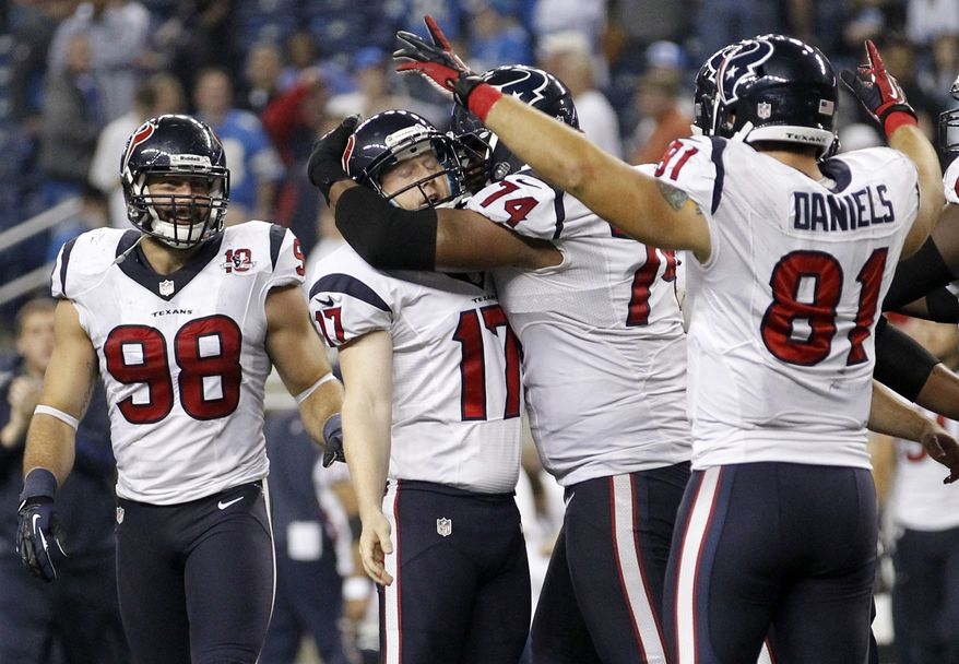 Houston Texans kicker Shayne Graham (17) is mobbed by teammates Wade Smith (74) and Owen Daniels (81) after kicking the game-winning field goal in overtime of an NFL football game against the Detroit Lions at Ford Field in Detroit, Thursday, Nov. 22, 2012. Looking on at left is Connor Barwin. The Texans won 34-31. (AP Photo/Rick Osentoski)