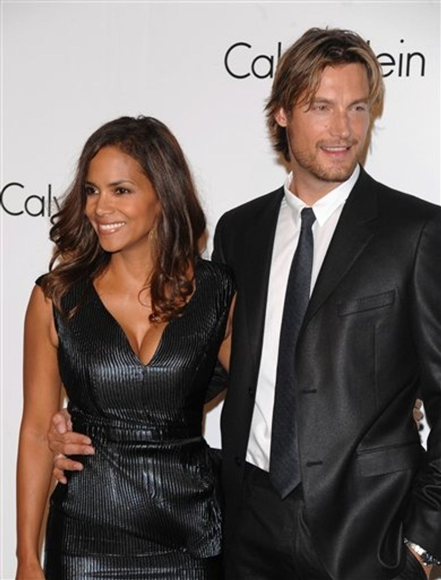 ** FILE ** Model Gabriel Aubry (right) and actress Halle Berry attend the Calvin Klein 40th-anniversary party during Fashion Week in New York in 2008. (AP Photo/Peter Kramer)