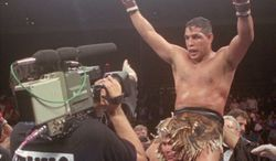 "** FILE ** This June 22, 1996, file photo shows Hector ""Macho"" Camacho being lifted into the air after his unanimous decision over Roberto Duran in an IBC middleweight title fight at the Trump Taj Mahal Casino Resort in Atlantic City, N.J. (AP Photo/Donna Connor, File)"