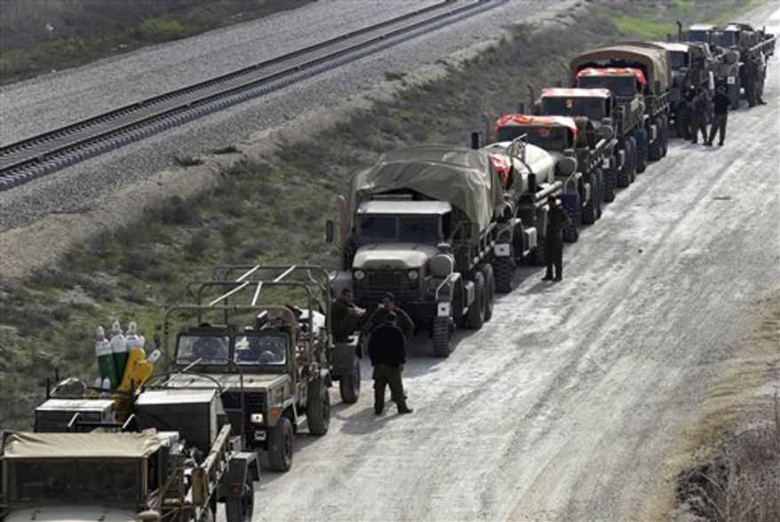 Israeli army vehicles form a convoy as soldiers prepare to drive out of southern Israel, near the Israel Gaza Strip Border, Thursday, Nov. 22, 2012. A cease-fire agreement between Israel and the Gaza Strip's Hamas rulers took effect Wednesday night, bringing an end to eight days of the fiercest fighting in years and possibly signaling a new era of relations between the bitter enemies. (AP Photo/Lefteris Pitarakis)