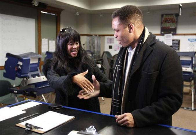 ** FILE ** This March 9, 2012, file photo shows Rep. Jesse Jackson Jr. , D-Ill., and his wife, Chicago Alderman Sandi Jackson, asking each other for their support and votes as they arrive at a polling station for early voting in Chicago. A spokesman for House Speaker John Boehner says he has received letter of resignation from Rep. Jesse Jackson Jr. Wednesday. (AP Photo/M. Spencer Green, File)