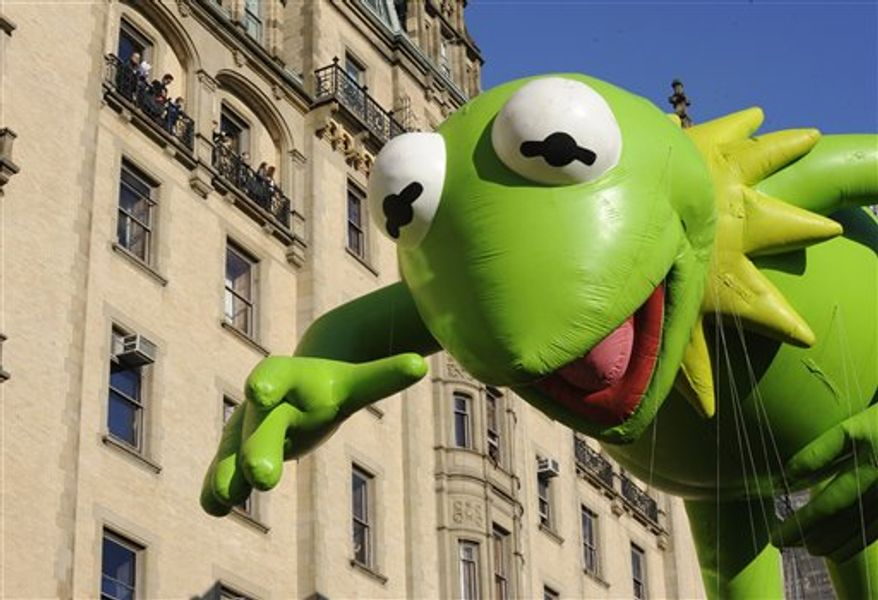 The Kermit The Frog balloon makes its way down New York's Central Park West in celebration of the 86th annual Macy's Thanksgiving Day Parade,Thursday, Nov 22, 2012. (AP Photo/Louis Lanzano)