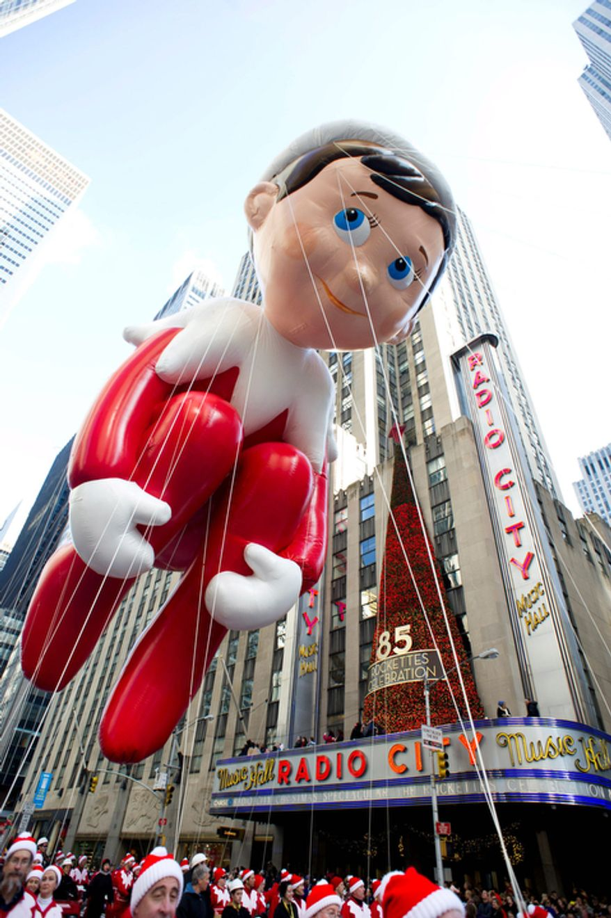 The Elf on the Shelf balloon floats in the Macy's Thanksgiving Day Parade in New York, Thursday, Nov. 22, 2012. The annual Macy's Thanksgiving Day Parade put a festive mood in the air in a city still coping with the aftermath of Superstorm Sandy (AP Photo/Charles Sykes)