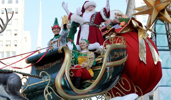 Santa Claus waves to the crowd at Herald Square during the 86th annual Macy's Thanksgiving Day Parade,Thursday, Nov 22, 2012, in New York (AP Photo/ Louis Lanzano)