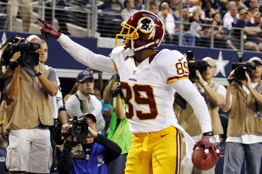 Washington Redskins wide receiver Santana Moss (89) celebrates a touchdown catch against the Dallas Cowboys in the first half of an NFL football game, Thursday, Nov. 22, 2012, in Arlington, Texas. (AP Photo/Tim Sharp)