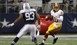 Dallas Cowboys outside linebacker Anthony Spencer (93) pressures as Washington Redskins' Robert Griffin III (10) prepares to pass in the first half of an NFL football game Thursday, Nov. 22, 2012 in Arlington, Texas. (AP Photo/Tim Sharp)