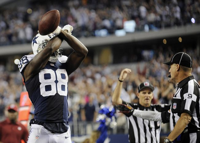 Dallas Cowboys wide receiver Dez Bryant (88) celebrates his touchdown against the Washington Redskins during the second half of an NFL football game Thursday, Nov. 22, 2012 in Arlington, Texas. (AP Photo/Matt Strasen)