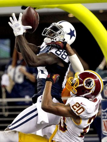 Washington Redskins defensive back Cedric Griffin (20) breaks up a pass in the end zone intended for Dallas Cowboys' Dez Bryant (88) late in the second half of an NFL football game, Thursday, Nov. 22, 2012, in Arli