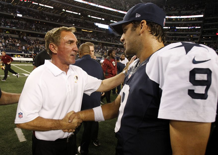 Washington Redskins head coach Mike Shanahan, left, shakes hands with Dallas Cowboys quarterback Tony Romo (9) following their NFL football game, Thursday, Nov. 22, 2012, in Arlington, Texas. The Redskins won 38-31. (AP Photo/Tim Sharp)