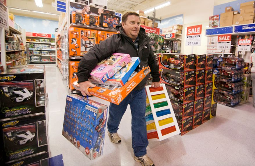 Bargain shopping is common in the holiday season, but parents are advised to buy the kids fewer toys so they will have time to play and appreciate thir gifts. (Craig Bisacre/The Washington Times)