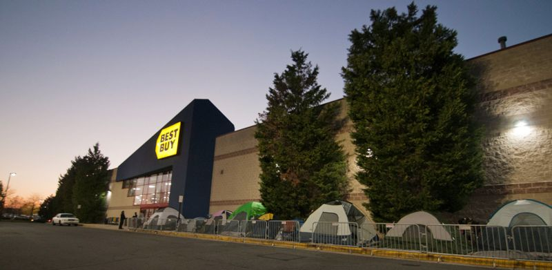 Shoppers wait in line to be let into Best Buy on Thanksgiving Day, Fairfax, Va., Thursday, November 22, 2012. One family had been waiting in line since Wednesday afternoon to be the first costumer. (Craig Bisacre/The Washington Times)