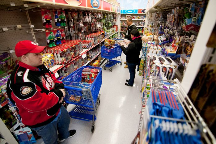 Shoppers look for bargains at the Toys 'R' Us store in Fairfax, Va., on Thanksgiving Day, Thursday, Nov. 22, 2012. (Craig Bisacre/The Washington Times)