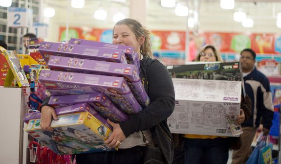 Shoppers look for bargains at Toys'R'Us on Thanksgiving Day, Fairfax, Va., Thursday, November 22, 2012.  The stores, which opened nationwide at 8PM, will remain open for 24 hours for Black Friday. (Craig Bisacre/The Washington Times)