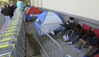 Shoppers wait in line outside of a Best Buy store in Colma, Calif., Thursday, Nov. 22, 2012. While stores typically open in the wee hours of the morning on the day after Thanksgiving known as Black Friday, openings have crept earlier and earlier over the past few years. (AP Photo/Jeff Chiu)