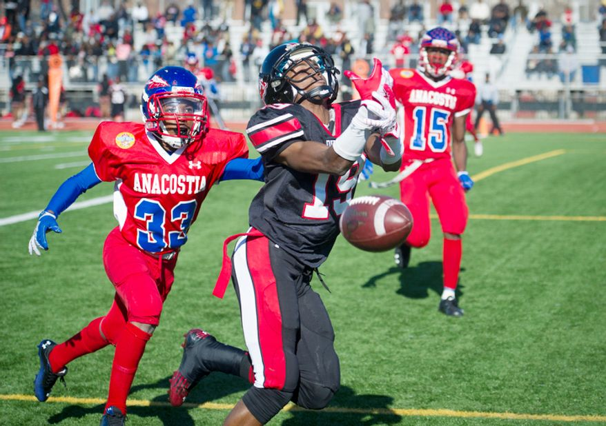 Anacostia's Xavier Harkum (33) breaks up a pass in the end zone intended for Dunbar's Michael Smith (19) in the first quarter during the 43nd Annual DCIAA Turkey Bowl Varsity Football Championship at Eastern High School in Washington, D.C., Thursday, Nov. 22, 2012. This game, played between two District high school football teams is rich in tradition and always played on Thanksgiving Day, however this year's contest had a slight change in the last few days leading up to the game when Woodrow WIlson High School was disqualified because one the team's players was found to have been a resident of Maryland. Anacostia High School was chosen as an alternative. (Rod Lamkey Jr./The Washington Times)