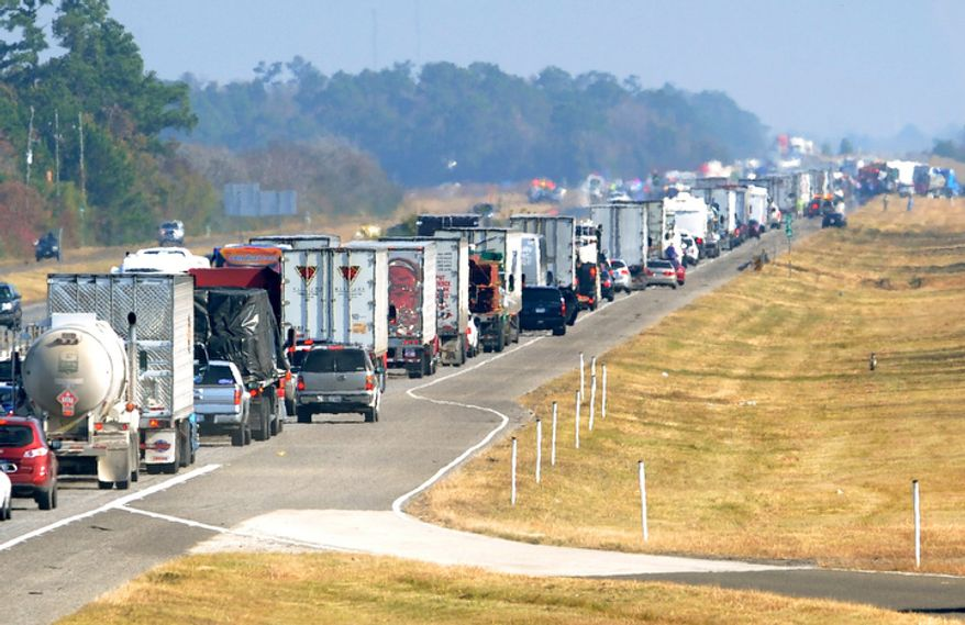 Traffic backs up on the east bound lane of Interstate 10 on Thanksgiving day Nov. 22, 2012 after a multi-vehicle accident in Southeast,Texas.  The Texas Department of Public Safety says at least 35 people have been injured in a more than 50-vehicle pileup that forced the closure of Interstate 10. (AP Photo/The Beaumont Enterprise, Guiseppe Barranco)