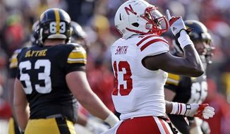 Nebraska safety P.J. Smith (13) reacts after Iowa missed a field goal during the first half of an NCAA college football game, Friday, Nov. 23, 2012, in Iowa City, Iowa. (AP Photo/Charlie Neibergall)